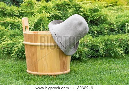 Wooden Bucket And Felt Hat For The Sauna.