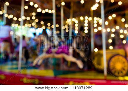 Blurred Defocused Background Of Traditional Fairground Vintage Carousel