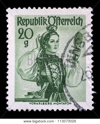 AUSTRIA - CIRCA 1948: A stamp printed in Austria shows image woman in national Austrian costumes, Vorarlberg, Montafon Valley, series, circa 1948