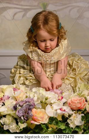Little girl in dress with flowers