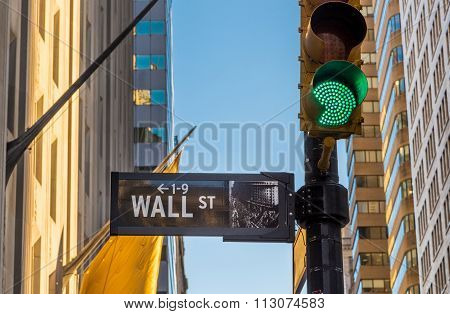 Wall Street Sign And Green Light.