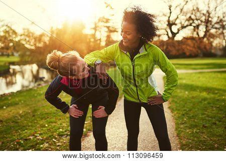 Two Sportswomen Relaxing After Jogging