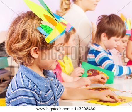Boy in crafting kindergarten class