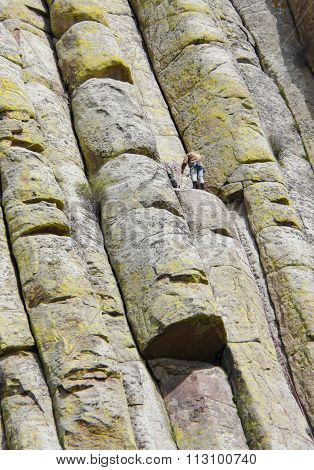 Mountain Climber On Devils Tower In Wyoming
