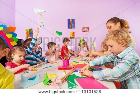 Creative preschool children with teacher