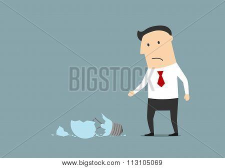 Upset businessman broke a light bulb