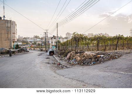 Arab Man Walkig Through Poor Suburbs Of Hebron During Riots In This Area.