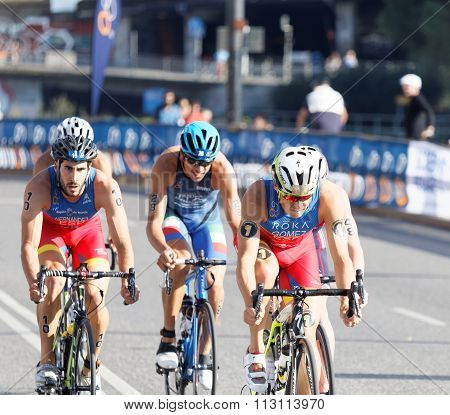 STOCKHOLM SWEDEN - AUG 23 2015: Concentrated colorful triathletes cycling Javier Gomez Noya (ESP) in the lead in the Men's ITU World Triathlon series event August 23 2015 in Stockholm Sweden