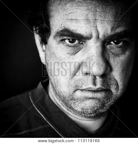Black and white portrait of an angry man looking depressed
