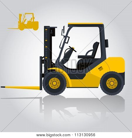 Yellow fork lift loader