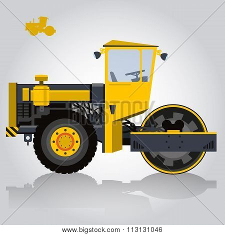 Yellow big roller builds roads