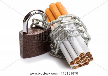Pack of cigarettes and a padlock with chain. concept stop smoking