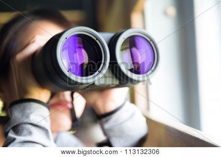 Woman looking though binoculars