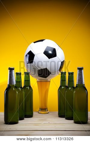 Beer collection and football on the yellow background. poster