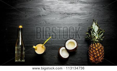 The Ingredients For The Cocktail - Pineapple, Coconut And A Bottle Of Rum . Free Space For Text.