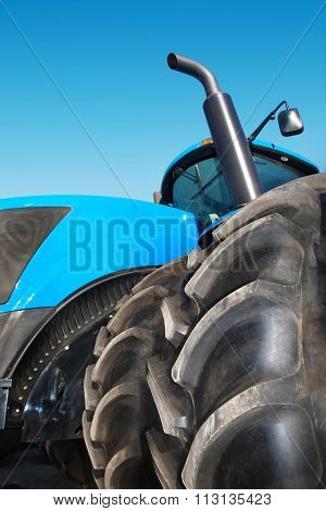 Tire On Blue Tractor Close Up