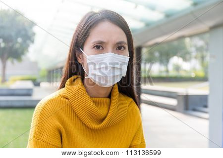 Asian Woman wearing face mask for protect from air pollution