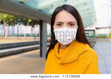 Asian Woman wearing the face mask at outdoor