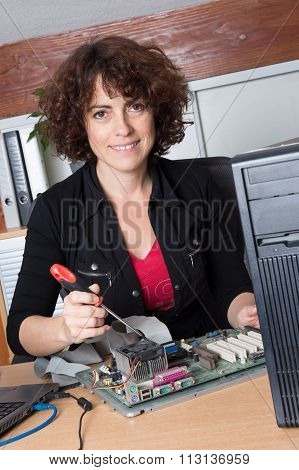 Smiling Female Support Computer Engineer - It Woman Repair Defect Computer