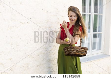 Passing by with basket of juicy apples