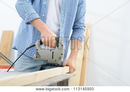 Pleasant man doing renovation