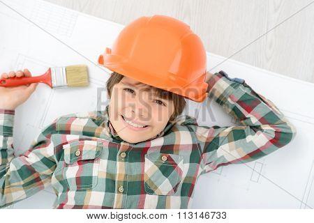 Little boy doing renovation