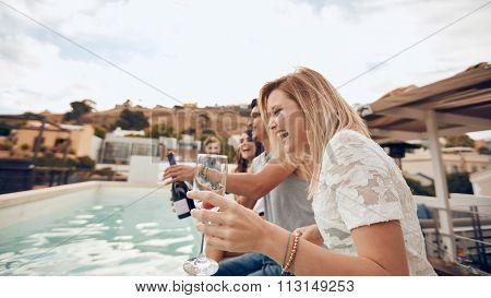 Friends Having Fun In Poolside Party