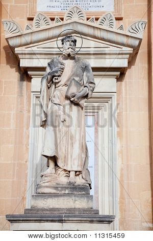 Sculpture of Saint Petr on wall of St. Mary church at Mosta Malta poster