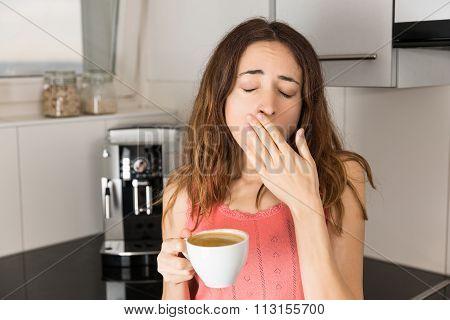 Sleepy Woman In The Morning Drinking Coffee
