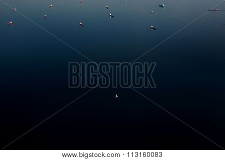 Amazing view from plane of a open sea with boats