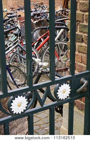 Bikes Behind Iron Gate Door, St John's College, Cambridge