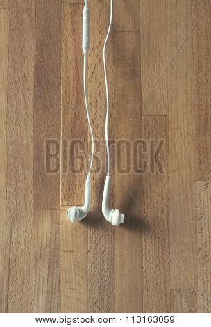 earplugs hanging on wood background