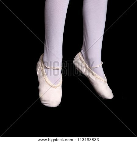 Legs And Feet Of Little Ballerina In Pointe