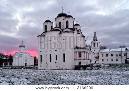 Churches in Yaroslav Courtyard in Veliky Novgorod Russia - architectural landscape in cloudy winter evening poster