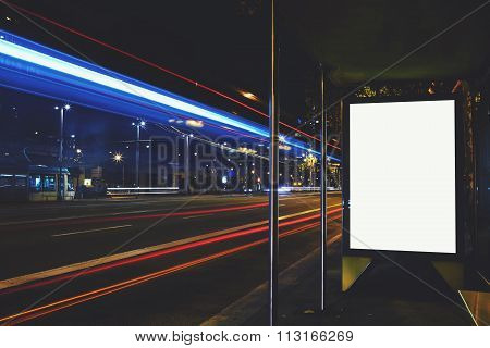 Advertising mock up banner on bus stop in night public