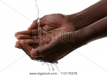 Hands washing concept. Water pouring into man hands isolated on white background