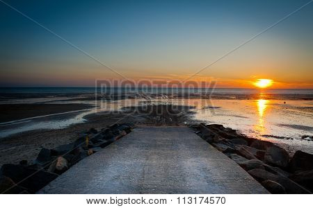 Sunset Landscape On The Beach During Low Tide