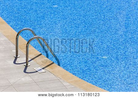 Edge of swimming pool.
