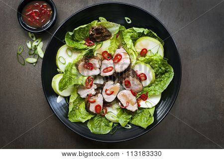 Pork salad with chili, pear and cos lettuce.  Grilled fillet marinated in plum sauce.