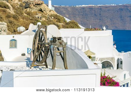 Spinning wheel in the stunningly beautiful town of Oia