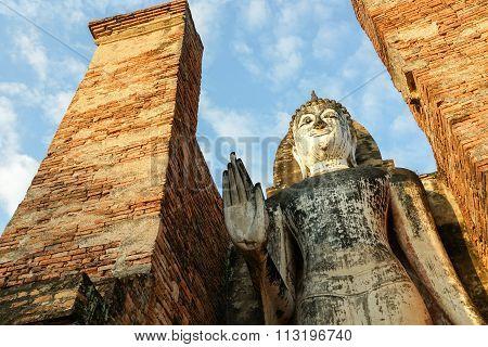 Buddha Buddhist temple ruins in Sukhothai historical park Wat Mahathat.