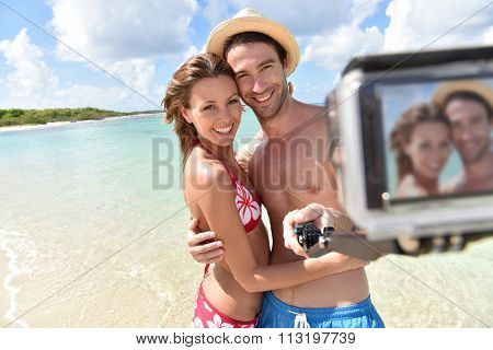 Couple at the beach taking selfie picture