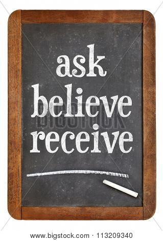 Ask, believe, receive - spiritual words on a vintage slate blackboard