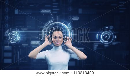 Young woman wearing headphones on virtual blue interface