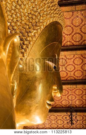 The Golden Giant Reclining Buddha (Sleep Buddha) in Wat Pho Buddhist Temple, Bangkok, Thailand