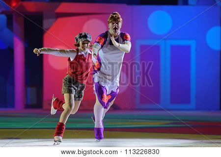 ST. PETERSBURG, RUSSIA - DECEMBER 29, 2015: Figure skaters Maria Petrova as Lillebror and Alexey Tikhonov as Froken Bock in a scene of New Year show of Ilya Averbukh in the Sports center Yubileyniy