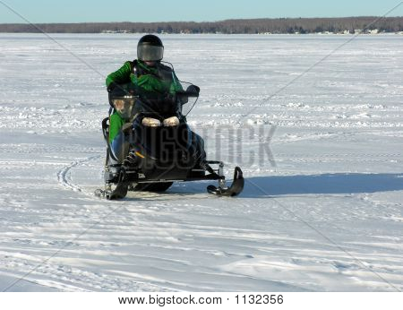Man And Dog On Snowmobile