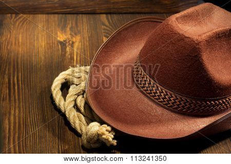 cowboy hat on wooden background