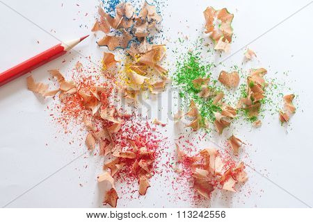 Colorful Pencil Sharpener  And Red Pencil On White Background