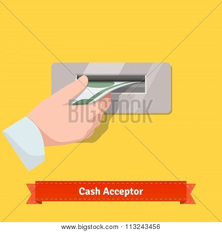 Human hand putting banknote to a cash validato